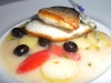 Branzino with campari tomatoes, Taggiasca olives and Vermentino veloute